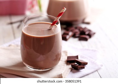 Glass of chocolate milk on table close-up