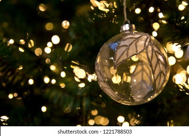 Glass christmas ball with silver leaves