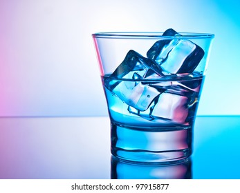 Glass of clear drink on the rocks