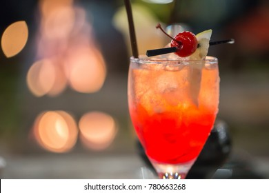 A Glass of Cocktail by a Bonfire at Night