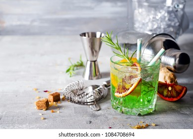 Glass of cocktail green fairy with lemon and absinthe