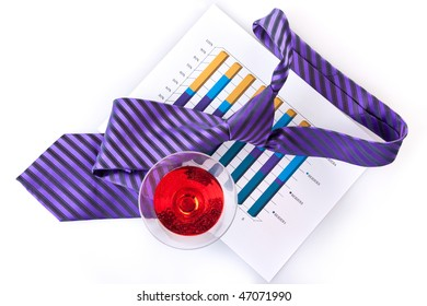 glass of cocktails, necktie and document (chart)