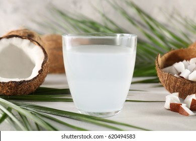 Glass of coconut water on table