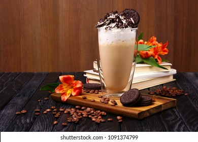 Glass with coffee cocktail with whipped cream and cookie decorated with coffee beans and flowers