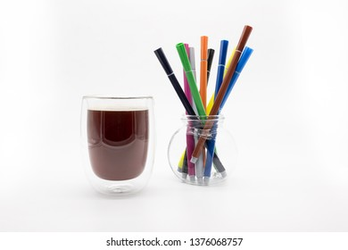 a glass of coffee and fiber pens, isolated on a white background