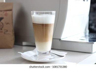 Glass of Coffee Latte. Cup of freshly brewed Cappuccino with Delicious Milk Foam. Minimal Food Styling.