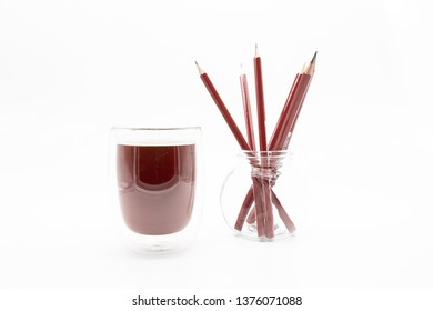 a glass of coffee and pencils, isolated on a white background