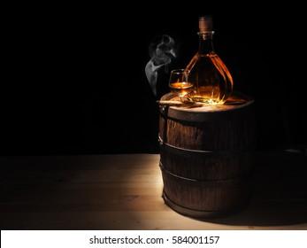 Glass of Cognac , Cigar and old oak barrel.