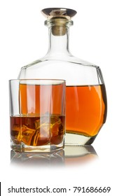 glass with cognac and ice, next bottle with cognac on white background