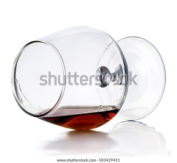 A glass of cognac isolated on white background.