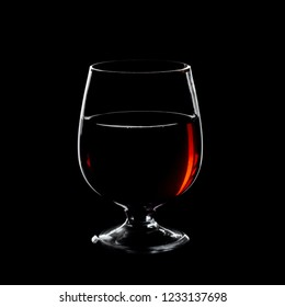 glass for cognac isolated over black background