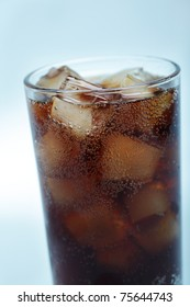 Glass of cola with ice closeup