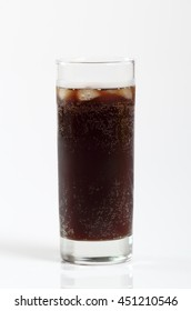 Glass of cola with ice cubes. Isolated on white background.
