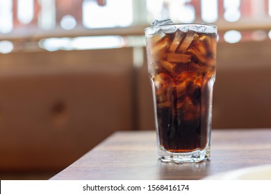 glass of cola with ice cubes,Drink Soda