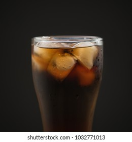 glass of cola with ice over black background