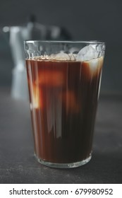 Glass with cold brew coffee on grey table