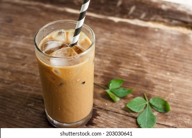 Glass Of Cold Coffee On Wood