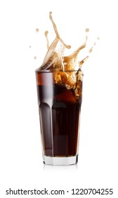A glass of cold cola with a splash of ice cubes. Isolated on white background.