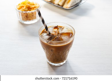 Glass of cold iced coffee with corn flake.