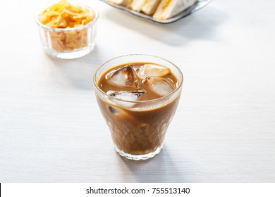 Glass of cold iced coffee with cornflake.