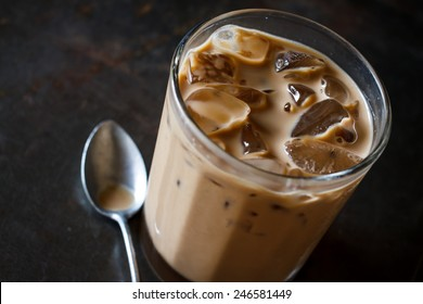 Glass Of Cold Iced Coffee On grunge tray, image dark tone