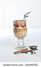Glass of cold latte coffee topic cocolate cream on isolated white background with desserts