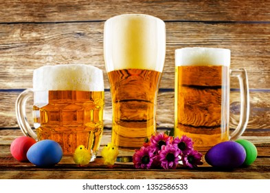 Glass of cold light beer with Easter decorations on a wood background for the Easter holidays. toning. selective focus
