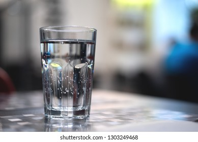 Glass of cold mineral water on the table.