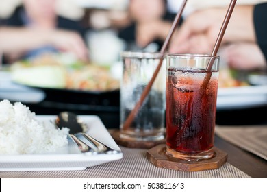 Glass of cold roselle juice on table food