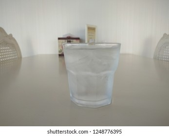 A glass of cold water on dining table.