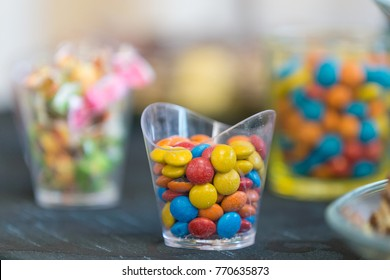 Glass of glass with colored candies