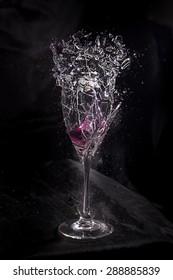 Glass containing liquid exploding.