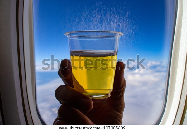 Glass Cool Beer Held Front Airplane Stock Photo Edit Now 1079056091