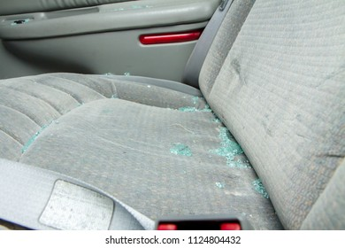 The glass could be from an auto accident, maybe a drunk driver, vandalism, or a car that was broken into