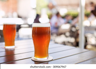 Glass of craft IPA beer on a table during beer festival in Belarus. India pale ale hoppy beer