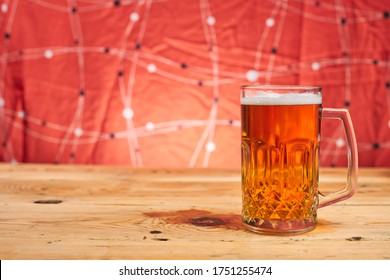 A glass of crafty beer. International beer day or Octoberfest concepts. Drinking beer after a hard working day in the pub. Watching football or soccer