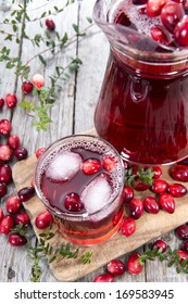 Glass with Cranberry Juice and Ice Cubes