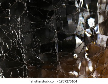 Glass with crazing and reflections abstract background closeup