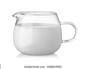 Glass glass creamer full of fresh cream isolated on white