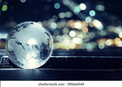 Glass crystal globe on laptop keyboard