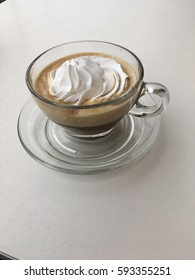 Glass Cup Of Coffee With Whipped Cream