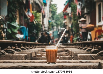 Glass Cup of cold Vietnamese coffee is on the railroad. Traditional Vietnamese drink. Hanoi, Vietnam