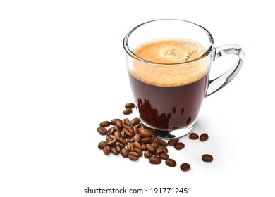 Glass cup of espresso coffee and coffee beans isolated on white background