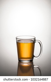 glass cup full of tea on glass table