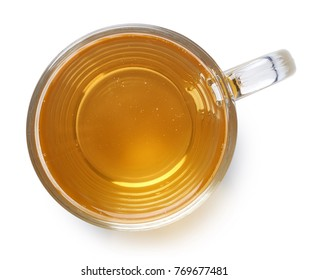 Glass cup of ginger lemon tea isolated on white background. Top view