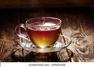 glass cup with herbal tea on a wooden background