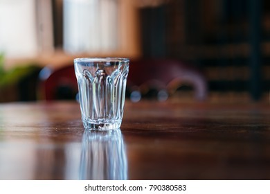 a glass cup on the table