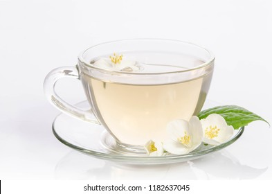 Glass cup of Tea with jasmine flowers and leaves