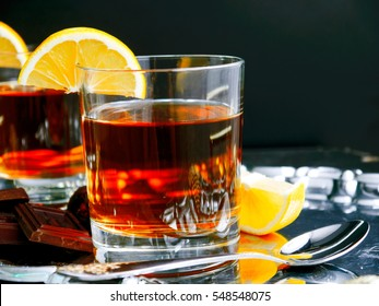 Glass Cup tea with lemon on a silver tray