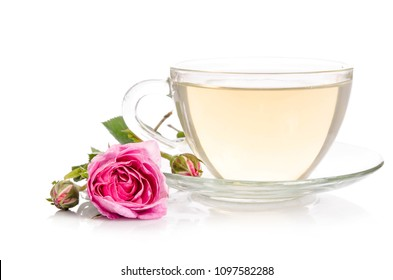 Glass cup of Tea with rose isolated on white background